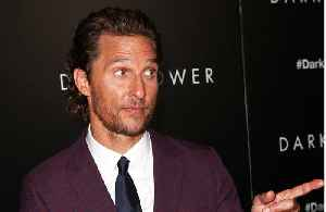 Matthew McConaughey wrestles with son [Video]