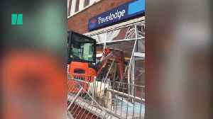 Man Rams Digger Into Liverpool Travelodge [Video]