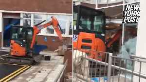 Pissed-off worker plows digger through Travelodge hotel lobby [Video]
