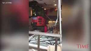 Man Exacts Revenge on a Hotel By Running a Digger Through Lobby [Video]