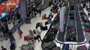 German thief, 39, caught stealing British woman's suitcase from airport baggage carousel [Video]