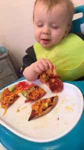 Sleepy Baby Enjoys Pizza [Video]