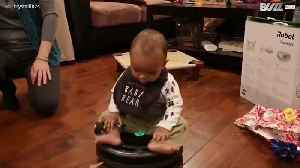 Baby enjoys a ride on robot vacuum cleaner [Video]