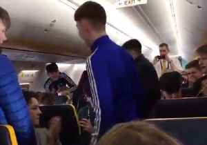 Trad Session Breaks Out Midair on Flight With Talented Irish Students [Video]