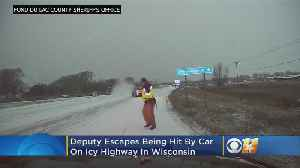 Deputy Narrowly Escapes Being Hit By Vehicle On Icy Road [Video]