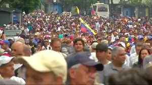Protesters flood Caracas streets to protest Maduro [Video]