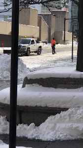 Viral video shows Akron employee using cup to spread salt [Video]