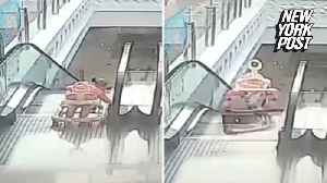 Hero saves baby moments after falling down escalator [Video]