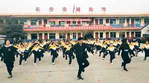 Watch: China school principal joins students for shuffle dance [Video]