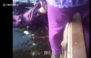 Old man rescued by police after falling into icy river in China [Video]