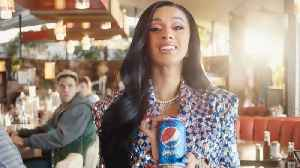 First Look At Cardi B's HILARIOUS Pepsi 'OKURRR' Superbowl Commercial With Steve Carrel! [Video]