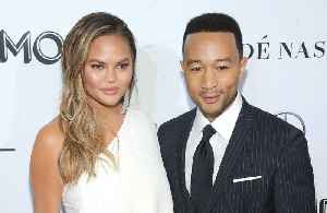 John Legend learning to swim at 40 [Video]