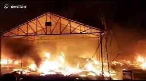 Massive fire burns down 200 stalls at Indian industrial exhibition, injuring nine [Video]