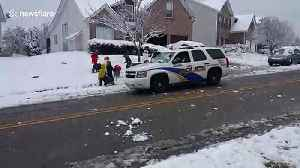 Friendly police join in snowball fight with neighbourhood kids [Video]