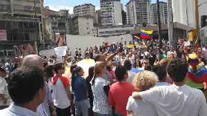 """Caracas Demonstrators Sing National Anthem, Wave Giant Flag, Chant """"I Want Nicolas to Go"""" [Video]"""
