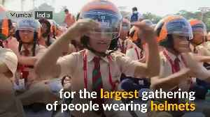 Children in helmets create new world record [Video]