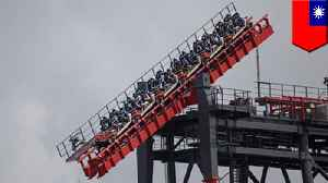 Riders hang 16 stories from tilting coaster after it malfunctions [Video]