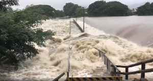Mighty Tide of Floodwater Swallows Bridge in Townsville [Video]