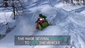 Woman stuck in snow with snowmobile [Video]