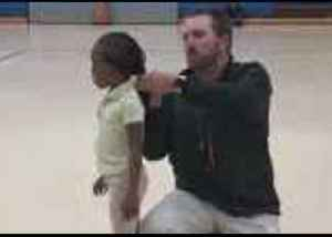 Coach Helps Fix Student's Hair During Gym Class [Video]