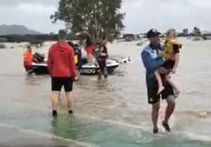 Rugby Players Rescue Children From Queensland Floods [Video]