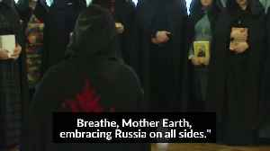 Russian witches unite in support of Putin with 'circle of power' [Video]