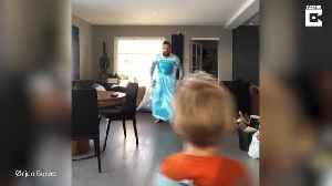 Dad and son really 'let it go' after dressing up as Frozen's princess Elsa for family singalong and go viral [Video]
