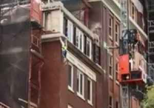 Builder Dangles From Construction Site After Scaffolding Breaks [Video]