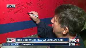 Longtime Red Sox fan signs team truck for first time [Video]