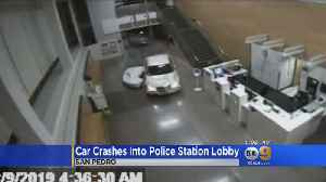 Car Crashes Into Police Station Lobby [Video]