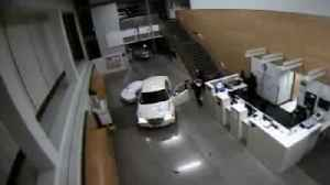 Woman With Infant In Vehicle Crashes Into Police Station Lobby [Video]