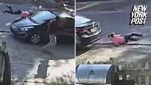 Hit-and-run suspect poses with damaged car after plowing into woman [Video]