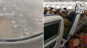 Passengers scream as plane aborts landing due to strong winds [Video]