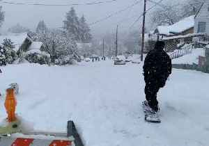 Snowboarders Shred on Olympia Streets as Winter Storms Continue [Video]