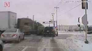 Watch as Semi Truck Runs Red Light and Crushes a Police Car [Video]
