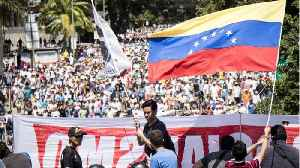 Venezuelan Opposition Takes To The Streets Urging Maduro To Let Aid In [Video]