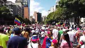 Thousands of Venezuelans march in Caracas to demand humanitarian aid be allowed to enter country [Video]