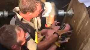 Baby is Rescued From Storm Drain in South Africa [Video]