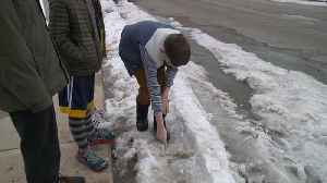 Nine-Year-Old Boys Find Suspect's Gun Buried in Snow While Waiting for School Bus [Video]