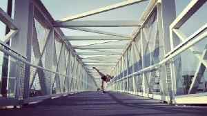 Girl Performs Martial Arts Tricking Routine Over Bridge [Video]