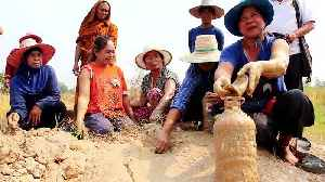Superstitious villagers drink and bathe in mud they believe has special powers [Video]
