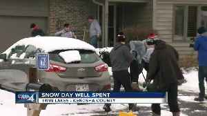 Wilmot Union High School football team spends snow day shoveling driveways [Video]