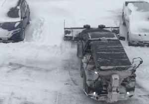 Plow Clears Parking Lot in Snow-Covered Stevens Point [Video]