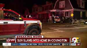 SUV slams into Covington home [Video]