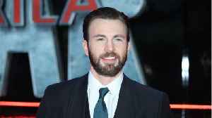 Chris Evans Wishes Fans A Happy Valentin's Day With Help Of His Pup Dodger [Video]
