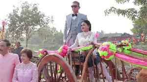 Couples get married in cow-drawn wooden carts to mark Valentine's Day [Video]