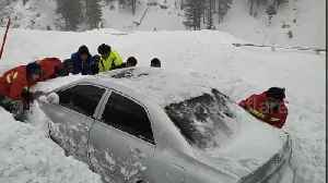 Rescuers save three vehicles buried in massive avalanches in China [Video]