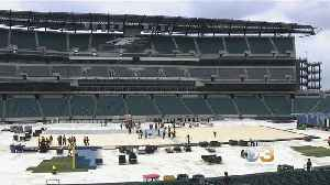 Crews Work To Transform Lincoln Financial Field Into A Hockey Rink [Video]