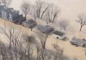 Helicopter Footage Shows Louisville Neighborhoods Submerged in Flooding [Video]
