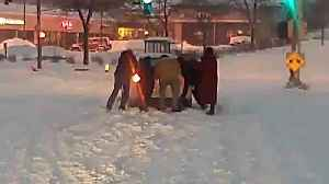 MCTS driver, passengers save driver stuck in snow on railroad tracks [Video]